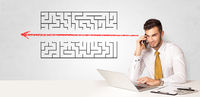Businessman presenting maze