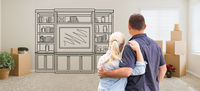 Couple Inside Empty Room with Moving Boxes Facing Entertainment Unit Drawing on Wall