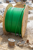 Cable drum with broadband cable on a cunstruction site