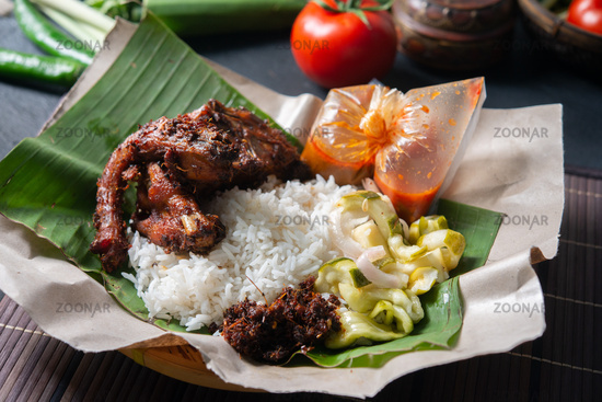 Nasi lemak kukus with quail