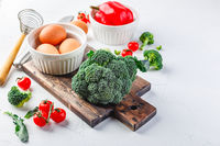 Healthy vegetables broccoli, tomato and bell pepper and eggs