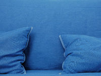 Blue couch with pillows