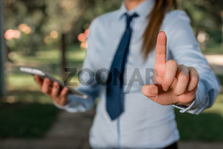 Handsome business girl pointing with finger into empty space. Copy space with pointing finger.
