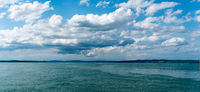 sailboat crossing Lake Constance on a beautiful summer evening