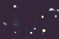 Big metropolitan city lights at night, blurry background