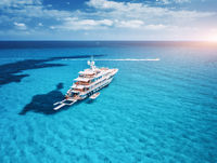 Yacht on the azure seashore in balearic islands at sunset
