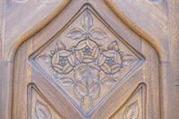 wooden door carved with flowers, Facades and traditional architecture in the old town of Barcelona, Spain