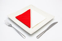 White square plate on the white wooden table.
