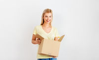 happy woman holding cardboard box