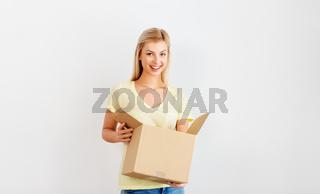 happy woman holding cardboard box