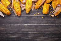 Corn Cobs On Wooden Table
