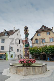 view of the historic 'Fontaine du Lion' or Lion Fountain in the Swiss city of Delemont