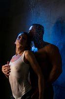 Loving couple in steamy embrace in shower shot