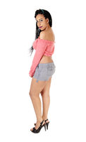 Woman standing in profile in jeans shorts