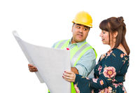 Hispanic Male Contractor Talking with Female Client Over Blueprint Plans Isolated on a White Background