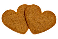 Two gingerbread cookies in a heart shape