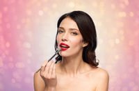 beautiful woman with make up brush for lipstick