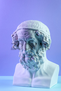 Gypsum copy of ancient statue Homer head on a blue background. Plaster sculpture man face.