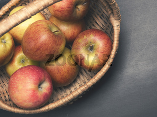 Fresh organic apples in a basket