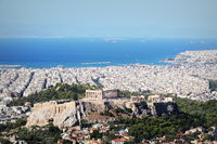 View over the city and the Acropolis from Lycabettus hill in Athens, Greece. Panorama of Athens . Beautiful cityscape with seashore