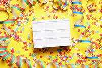 party celebration flat lay with confetti and streamers