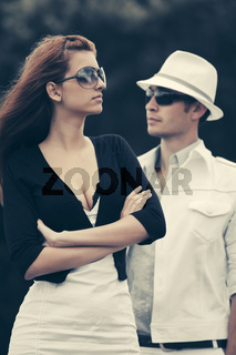 Young fashion couple in conflict outdoor