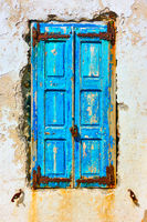 Old window with closed shutters