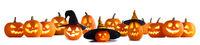 Many Halloween pumpkins on white