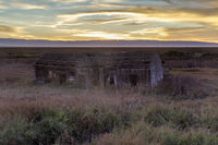 Sunset over abandoned house at Drawbridge, the last remaining ghost town in San Francisco Bay Area.