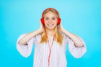 Dancing girl listens to music in earphones