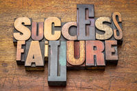 success and failure - word abstract in wood type