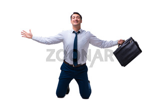 Excited businessman siiting on the knees isolated on white backg