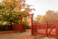 Klampenborg, Denmark - 15 october 2018: The Red Gate to Jaegersborg Dyrehave. This gate is located next to the Klampenborg Station. Autumn colors