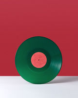 Vinyl retro record on a double red white background with copy space. Audio technology concept