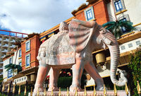 Statue of elephant against exterior of house turned upside down in Katmandu Park