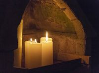 niche with burning candles