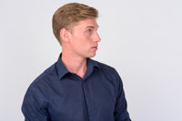 Profile view of young handsome businessman with blond hair