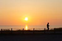 Silhouetted Man at Sunset