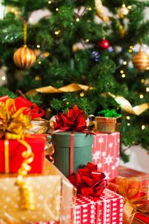 Christmas presents heap, lights on the Christmas tree