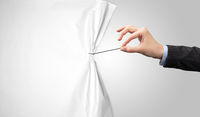 hand pulling white paper curtain