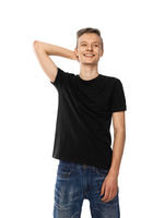 young teenager in black t-shirt and jeans smiles