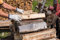Wooden logs are conceded for winter as firewood stock - close-up