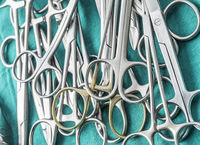 Scissors surgical in an operating theater, composition horizontal, conceptual image