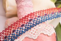 Color lace ribbons among flowers view