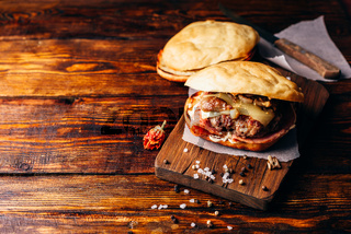 Homemade Burger on Cutting Board.