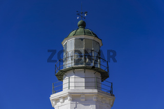 Deserted lighthouse against blue background.