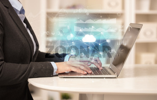 Business woman working on laptop with cloud technology concept
