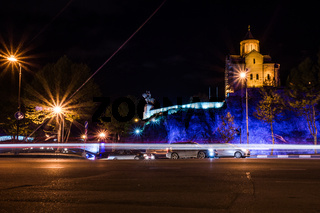 meteki church at night with street and driving cars in front