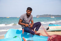 Fisherman at Trincomalee Beach, Sri Lanka