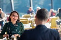 youn couple enjoying lunch at restaurant